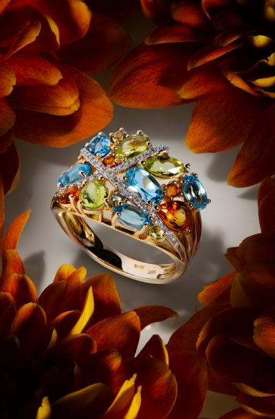 Jewelry photography of diamond ring on flowers
